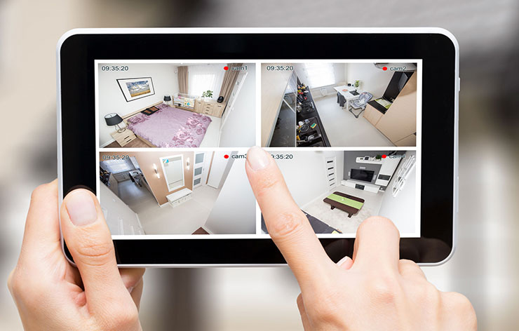 Tablet displaying four different rooms within a home
